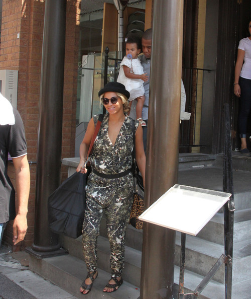 Jay-Z and Beyonce Knowles take their daughter Blue Ivy out to lunch at the Cafe Nervosa in Toronto on July 17, 2013.