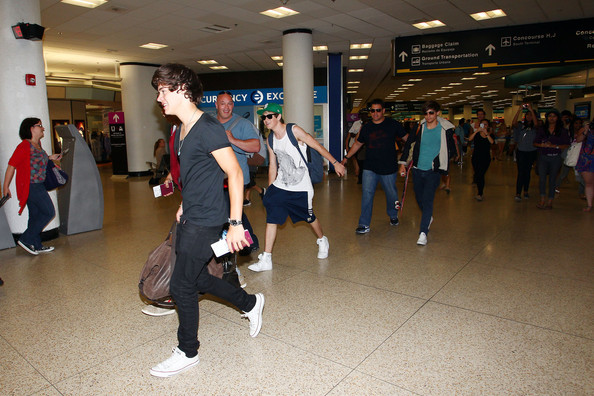 British boy band One Direction prepares to leave the US as they arrive at the airport in Miami.