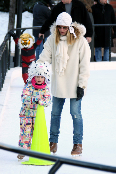 Heidi Klum sticks close to her daughter Helene while doing a bit of ice skating in Aspen. Heidi and husband Seal take their kids ice skating while spending their holiday in Aspen. Heidi strapped on a pair of ice skates to accompany her kids Helene, Henry and Johan on the ice. The kids were wearing animal shaped helmets and one piece jump suits. Seal kept to his sneakers and camera, taking pictures of wife Heidi and his kids skating around the rink.