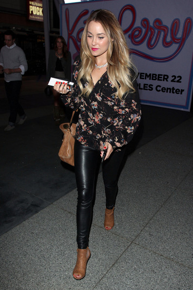 """The Hills"" star Lauren Conrad dons some skintight PVC trousers to watch Katy Perry perform her ""California Dreams"" tour at the Nokia Theater in Los Angeles."