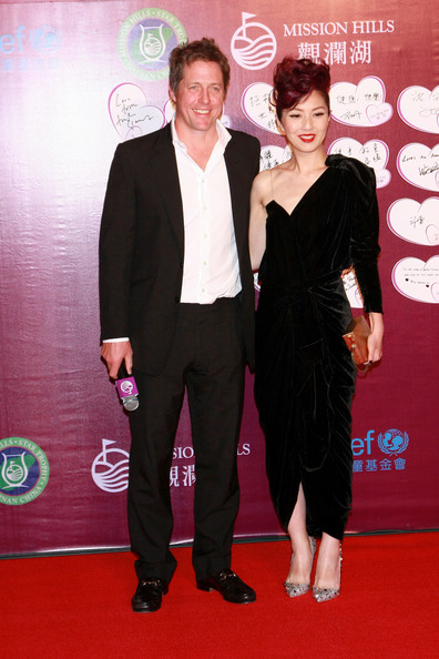 Hugh Grant October 29, 2010. Hugh Grant and Hong Kong singer Miriam Yeung attend the Mission Hills Star Trophy Gala in China. The Mission Hills Star Trophy is Asia's celebrity golf pro-am tournament, being held from 28 to 31 October, 2010, to promote the tourism of Hainan district.