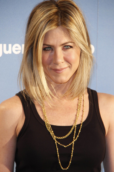 "Jennifer Aniston Jennifer Aniston sports a funky new blonde bob at the Spanish premiere of ""Just Go With It"" at Room Mate Oscar Hotel in Madrid."