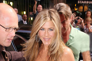 Jennifer Aniston arrives at London's Harrods department store to launch