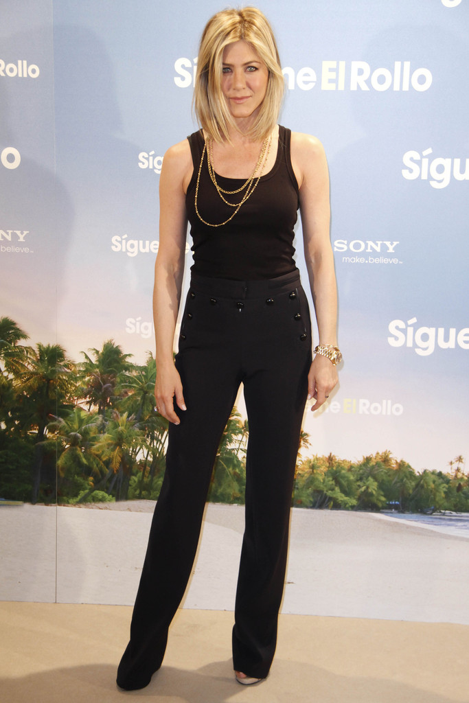 "Jennifer Aniston sports a funky new blonde bob at the Spanish premiere of ""Just Go With It"" at Room Mate Oscar Hotel in Madrid."