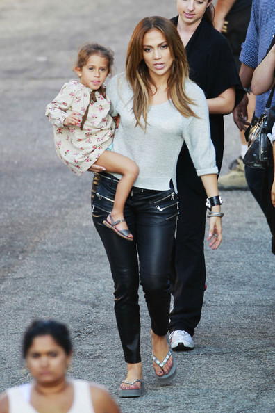 Jennifer Lopez holds her daughter Emme as she walks on the set of her ...