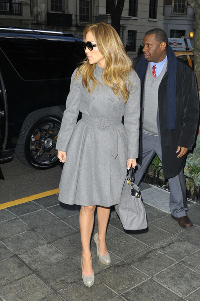 Jennifer Lopez and boyfriend Casper Smart arriving back at their New York City hotel after visiting the Sony Music Studios. Lopez was seen wearing a simple, double breasted, grey coat after wearing a white faux fur coat.