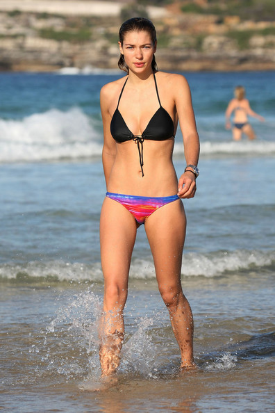 Jessica Hart, Australian Victoria's Secret model, cools off in the ocean after taking a jog on Bondi Beach. Jessica worked on her model's physique by jogging two laps alongside the water's edge.