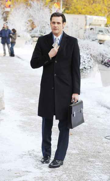 """Jim Carrey spotted on the set of """"Mr. Popper's Penguins,"""" based on the children's novel, filming on location near Madison Square Park in NYC. Carrey was spotted making funny faces at his co-star Ophelia Lovibond while walking in the snow."""