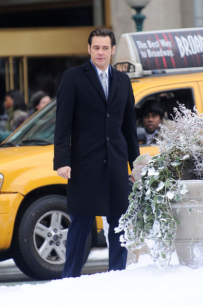 "Jim Carrey spotted on the set of ""Mr. Popper's Penguins,"" based on the children's novel, filming on location near Madison Square Park in NYC. Carrey was spotted making funny faces at his co-star Ophelia Lovibond while walking in the snow."