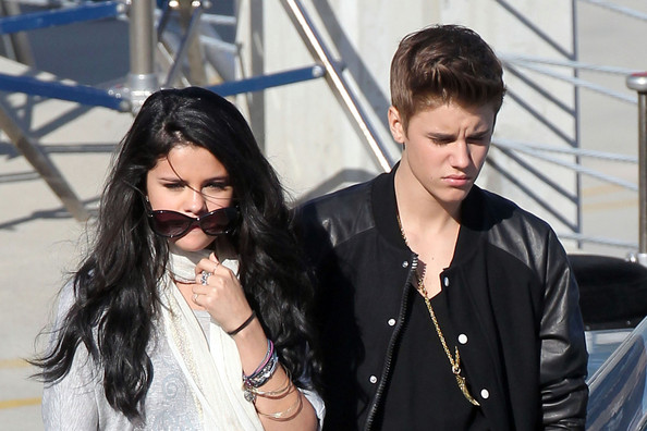 "Justin Bieber - SELENA VISITS JUSTIN ON SET! Justin Bieber and Selena Gomez embrace and kiss as she visits him on the set of his new music video ""Boyfriend"""