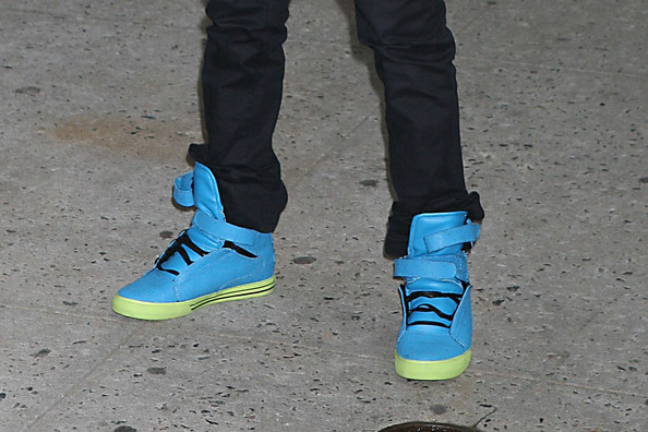 "Justin Bieber outside of the Late Show with David Letterman - wearing some bright neon kicks! The 16 year old pop sensation has a big reason to smile today - his album ""My World 2.0"" just dropped! Justin will be performing on ""Saturday Night Live"" next month and in June, the Canadian popstar is going to be launching an area tour. No wonder Bieber's in a good mood..."