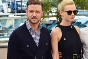 Justin Timberlake and Carey Mulligan attend the photocall for 'Inside Llewyn Davis' during the 66th Annual Cannes Film Festival at Palais des Festivals in Cannes.