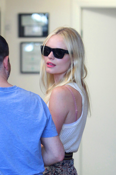 Kate Bosworth embraces the hot L.A. day, wearing a floral skirt and tank top, as she pays a visit to Macworld with a male friend.
