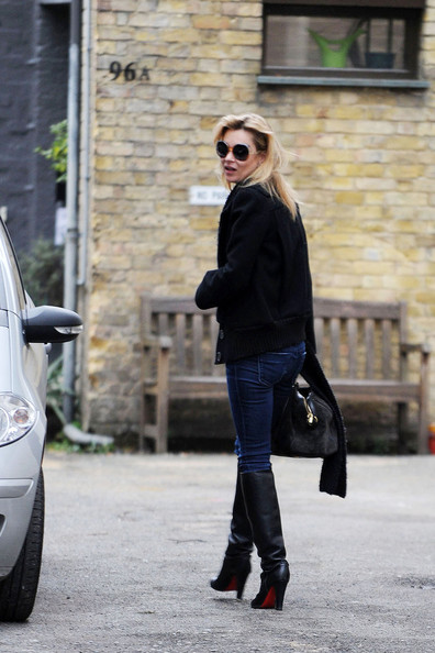 Kate Moss, in a simple black sweater and boots ensemble, is joined by her nanny Fiona as they leave her house to head to the Clifton Arms Pub in St. Johns Wood.