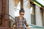 Katie Holmes, wearing a plaid button up and high waisted jeans, heads out to a Brazilian restaurant in New York City. Katie was spotted earlier in the day carrying a sleepy Suri while out and about with step-daughter Isabella.