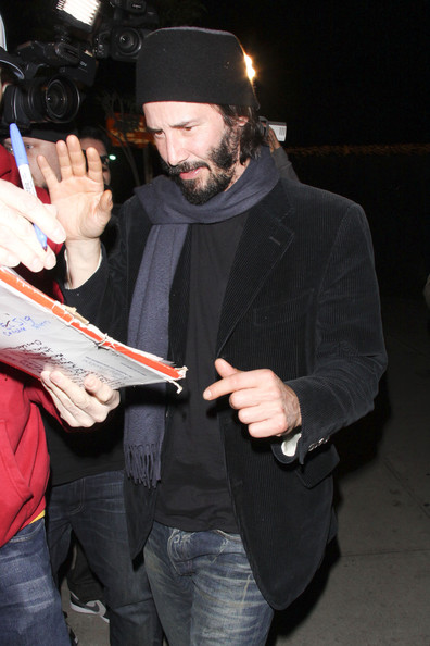 Keanu Reeves shields his face outside BOA restaurant in Los Angeles.