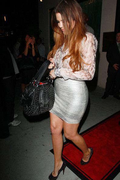 """Khloe Kardashian Khloe Kardashian rocks a skintight silver skirt as she leaves Mastro's Steakhouse in Beverly Hills. Khloe dined with husband Lamar Odom along with brother Rob and his """"DWTS"""" dance partner Cheryl Burke after their premiere performance on the show."""