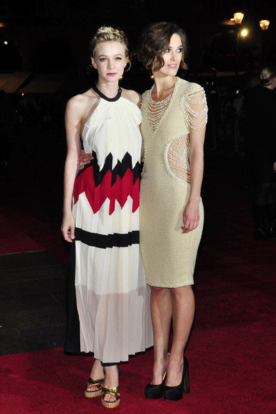 "Wednesday October 13 2010, Kiera Knightley and Carey Mulligan glam up for the premiere of their new film, ""Never Let Me Go""  in Leicester Square, London. Carey was wearing a Vionnet Spring 2011 colour-block halter with Vionnet gold wedges. Kiera wore a stunning cream knit Chanel Couture dress with pearl detail."
