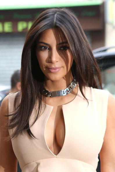 Kim Kardashian shows off her cleavage in a rather revealing top as she is spotted doing a bit of retail therapy in Paris.