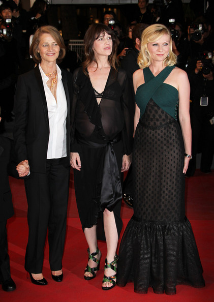 "Charlotte Rampling, Charlotte Gainsbourg, and Kirsten Dunst at the red carpet arrivals for the film ""Melancholia"" at the 64th Cannes Film Festival ."