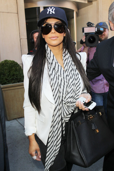 leaves kim kardashian wearing a new york yankees hat and a rather large ring
