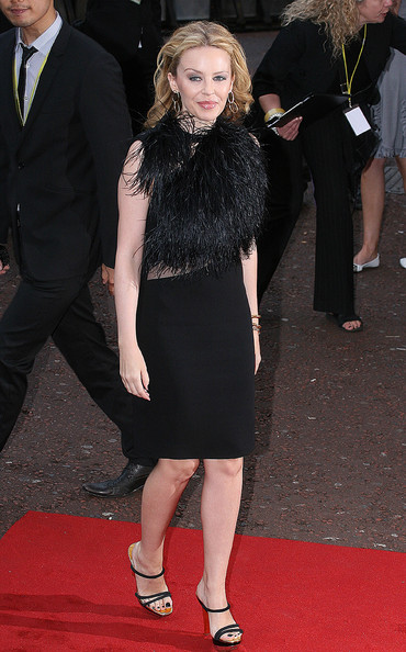 Kylie Minogue shines in a black feathered number at the premiere of