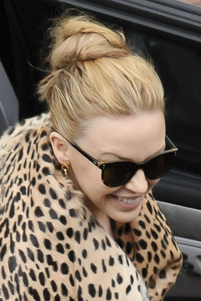 "Kylie Minogue wears a leopard print coat to greet her Sydney fans before her ""Aphrodite"" show. The Australian singer was at the Entertainment Centre and stopped to sign autographs before she takes to the stage later today."