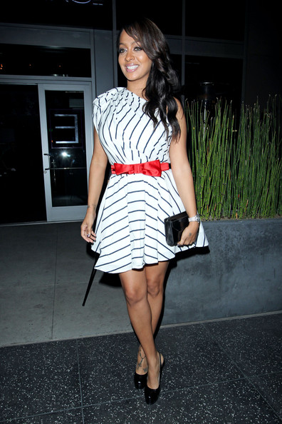 La La Vazquez Lala Vasquez wears a striped one-shouldered dress to Cafe Entourage in Hollywood.
