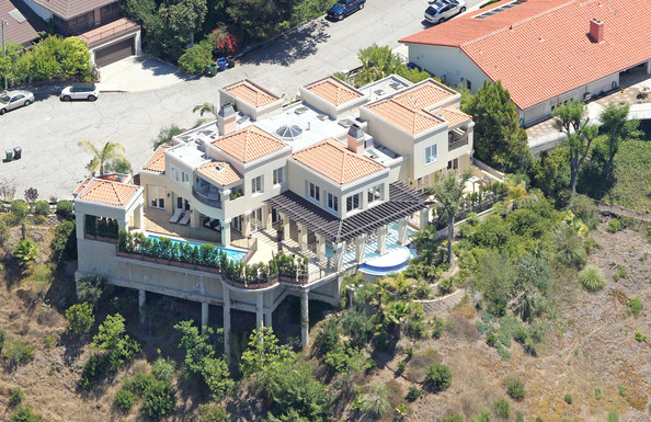 July 14, 2010. Lady GaGa has leased this $7 million home in the hills of Bel Air which had been listed for rent at a price of about $25,000 per month. The pop diva, whose real name is Stefani Germanotta, leased this 6 bedroom, 8 bathroom Mediterranean estate in October of 2009. According to listing information the high-walled and gated residence, located at the end of a quiet cul-de-sac, has 6,143 square feet of interior living space. Amenities include a double height entry with marble floors and a curving staircase, french doors throughout, an office/ library that opens to the pool terrace with outdoor kitchen. The hillside property has a resort-style swimming pool and spa with a terrace that hangs over a canyon with unobstructed panoramic views of the city.