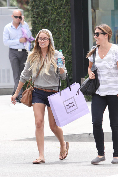 "Lauren Conrad Lauren Conrad, ex-star of ""The Hills"" and later ""The City,"" does a bit of shopping at Herve Leger by Max Azria's store in LA wearing a hoodie and denim cutoff shorts."