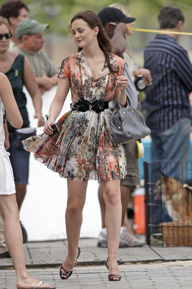 "Leighton Meester Leighton Meester and Clemence Posey are directed by Andrew McCarthy while filming scenes for ""Gossip Girl"" in Long Island City. Meester was spotted wearing a multi-colored floral dress, black high heels and a high waisted belt, which she was pictured taking off. Clemence could be seen holding onto a small dog which both her and Leighton doted over during breaks in filming."