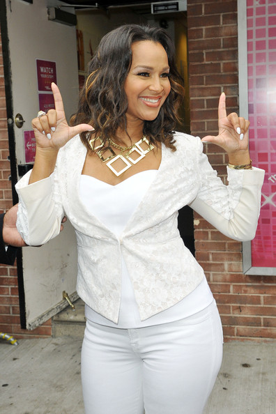 'Single Ladies'  actress LisaRaye McCoy  gives a wave and signs autographs outside of the 'Wendy Williams Show' in New York City.