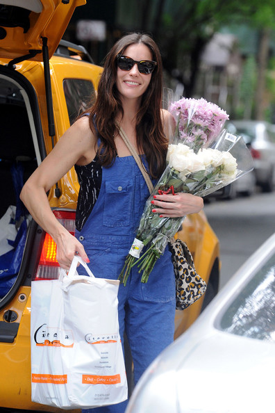"Liv Tyler Liv Tyler is all smiles as she spends her labor day out and about in New York City. Tyler, whose newest film ""The Ledge"" recently premiered at the Sundance Film Festival, could be seen arriving home in a taxi with flowers and a shopping bag."