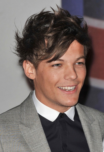 Louis Tomlinson Louis Tomlinson attending The Brit Awards 2012 at The O2 Arena in London.