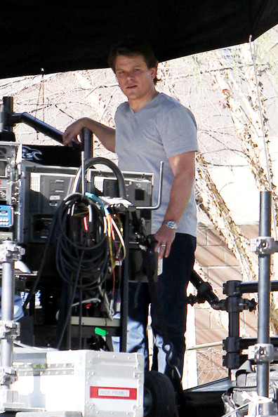 "Matt Damon chats with director Cameron Crowe on the set of Crowe's upcoming film ""We Bought a Zoo"". Damon, who looks a bit heavier set, is seen sitting behind-the-scenes with headphones on, reviewing a scene they had just filmed."