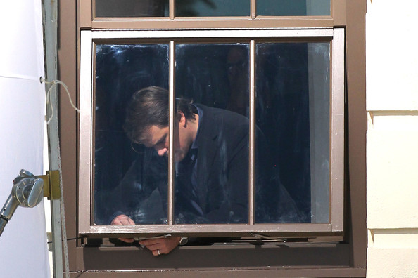 "Matt Damon tinkers around with a window sill during a scene for his upcoming film ""We Bought A Zoo"" in LA."