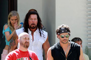 "Muscle man Joe Manganiello, wearing a black sleeveless sweater and a bandana, and co-star Kevin Nash finish a scene on the set of the upcoming stripper film ""Magic Mike"" in Los Angeles. Manganiello  is best known for his role in the hit TV series, ""True Blood."