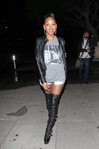 Actress Meagan Good showing off her thigh tattoo in knee high boots and