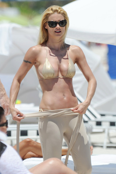 A.Swiss model and tv presenter Michelle Hunziker hits the beach in a micro ...
