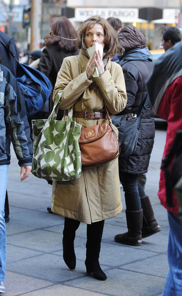 "Michelle Pfeiffer has a case of bad luck as her character falls onto several trash bags while crossing a busy street in NYC during a scene for ""New Year's Eve"". The brunette actress is seen holding tightly onto a piece of paper while trying to maneuver through a busy intersection, holding onto several bags and sporting an oversize beige coat."