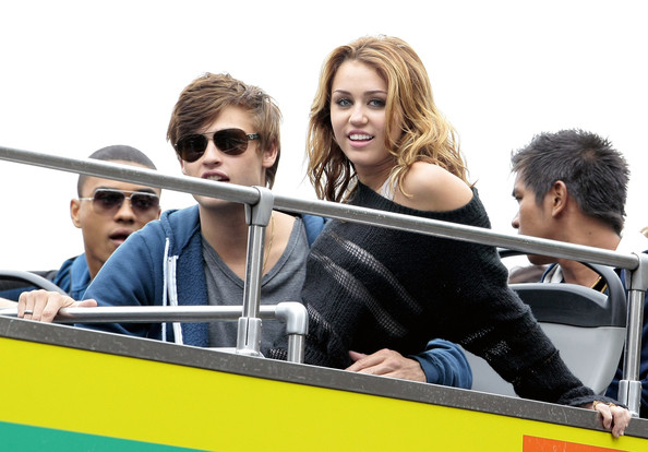 Miley Cyrus Starlets Miley Cyrus and Ashley Greene on the set of their new movie