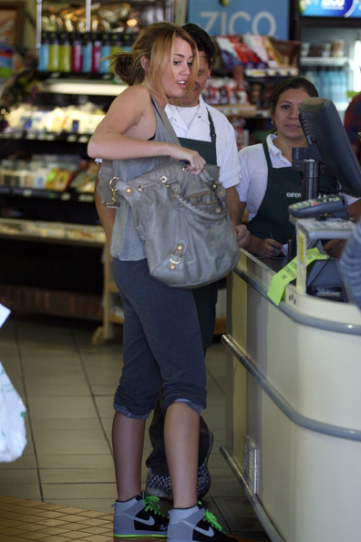 Miley Cyrus Miley Cyrus picks up a few juice drinks at the Erewhon Natural Foods grocery store wearing a sheer gray top and Nike dunk sneakers. Photograph: © Matt Symons, .