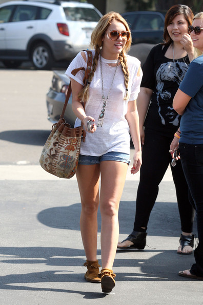 Miley Cyrus Miley Cyrus leave Paty's Restaurant looking a bit nippy after having breakfast at the diner with her mother Tish and sister Noah. The pop singer is seen with her hair in braids and sporting a ripped white t-shirt with denim shorts.
