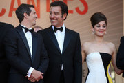 Guillaume Canet, Clive Owen and Marion Cotillard attend the Premiere of 'Blood Ties' during the 66th Annual Cannes Film Festival at the Palais des Festivals in Cannes.