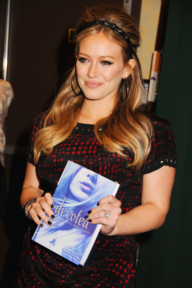"Mother-to-be Hilary Duff signs copies of her new book ""Devoted"" for fans at Barnes and Noble in New York City. ""Devoted"" is the sequel to Duff's first novel, ""Elixir,"" which made the New York Times Best-Seller's list."