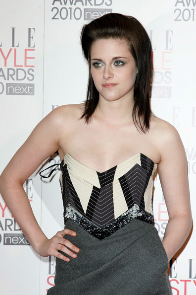 Kristen Stewart wears an Emilio Pucci dress with embellished corset to the 2010 Elle Style Awards at the Grand Connaught Rooms in London.
