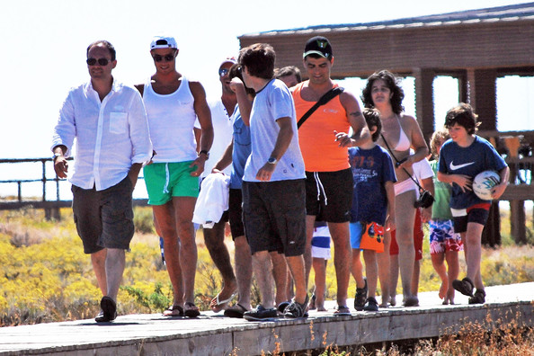 Cristiano Ronaldo New dad Cristiano Ronaldo spends time with friends and family on his home turf in the Algarve, Portugal. The group took a luxury yacht to Ilha Deserta in Oura. Ronaldo - seen in green shorts and white vest - sunned himself on deck! His family are looking after his new baby - also called Cristiano Ronaldo.