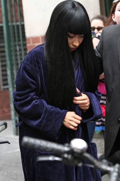 Nicki Minaj bundles up in a large navy robe as she heads out on the set of 'The Other Woman' in New York City.