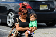 Nicole 'Snooki' Polizzi takes her little guy Lorenzo LaValle for swimming lessons at a gym in New Jersey. The former 'Jersey Shore' star bathed her nearly 1 year old son in affection on their way in and out of the gym.