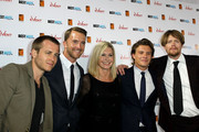 """Kevin Bishop, Tim Draxl, Olivia Newton-John, Xavier Samuel and Kris Marshall attend the premiere of """"A Few Best Men"""" at the Event Cinema in Bondi Junction in Sydney, Australia."""
